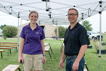 Kim Kerschen helps keep the field day running on schedule, and Nathan Nelson teaches one of the learning stations. We have lunch under these tents at noon.