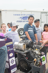 Members of the Quarter Scale Tractor Team build a new tractor each year for a competition. The team members talk to the 4th graders about how they design the tractor and put all of the parts together.